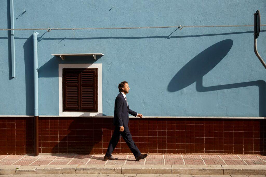 the groom walks towards the ceremony venue of wedding in sicily