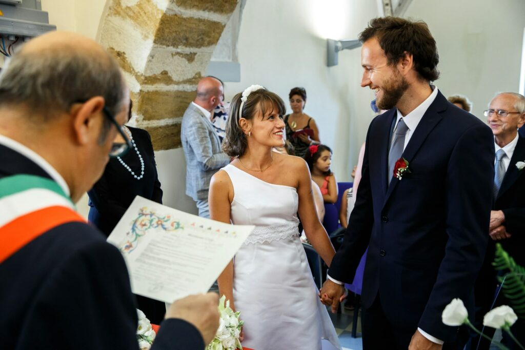 bride and groom first look in the town hall for their wedding in sicily