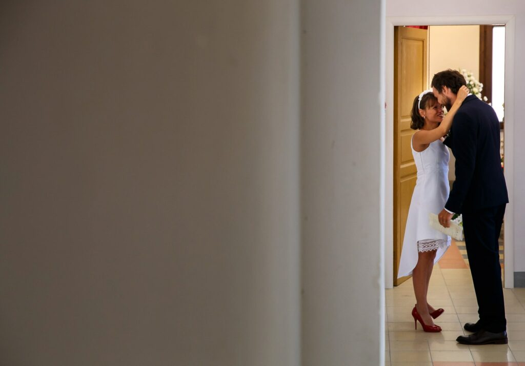 a tender moment between bride and groom after the ceremony