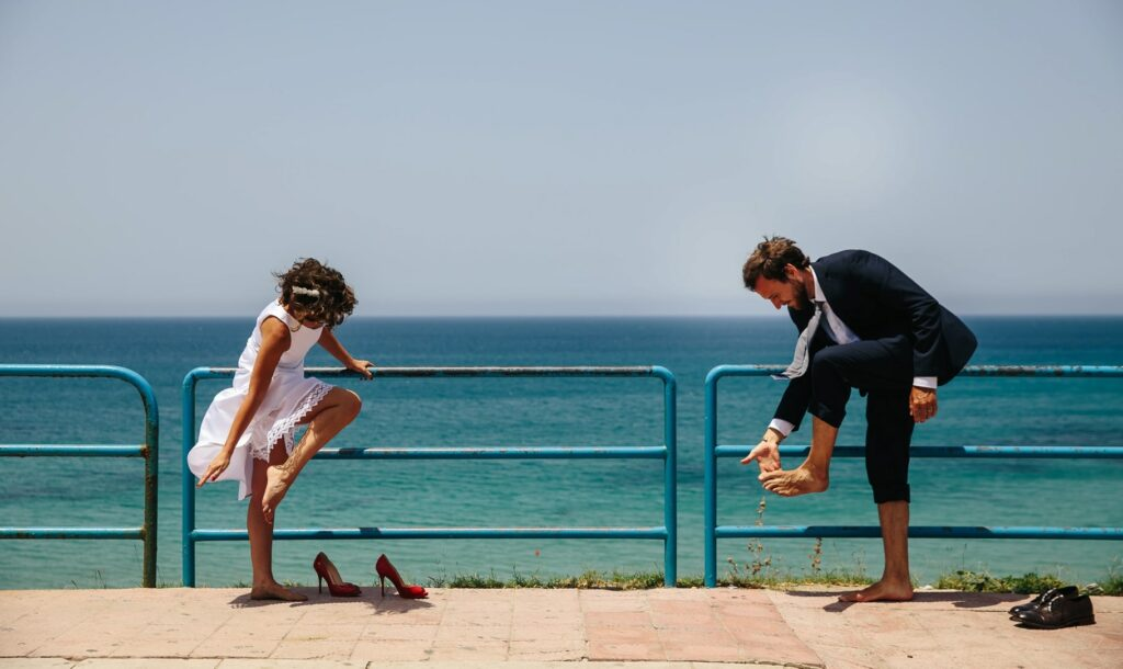 bride and groom near the beach on their wedding day in sicily