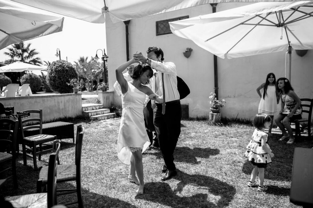 groom and bride dancing at the reception of wedding in sicily