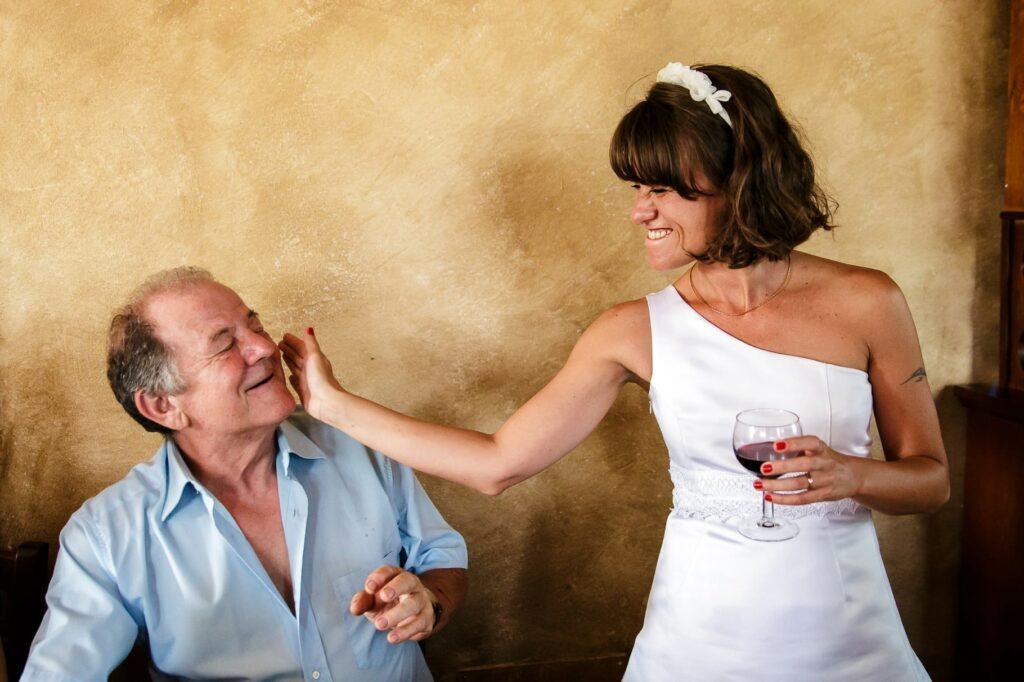 bride caressing a wedding guest