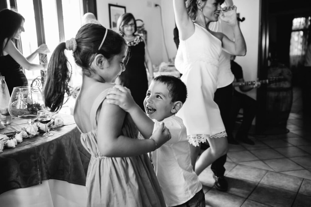 children dance at the reception of the wedding in sicily