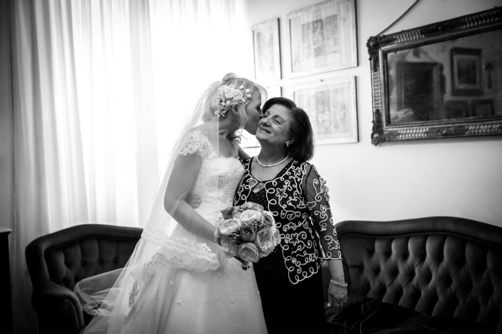 bride giving a kiss to her mother in a photo captured by villa miani wedding photographer