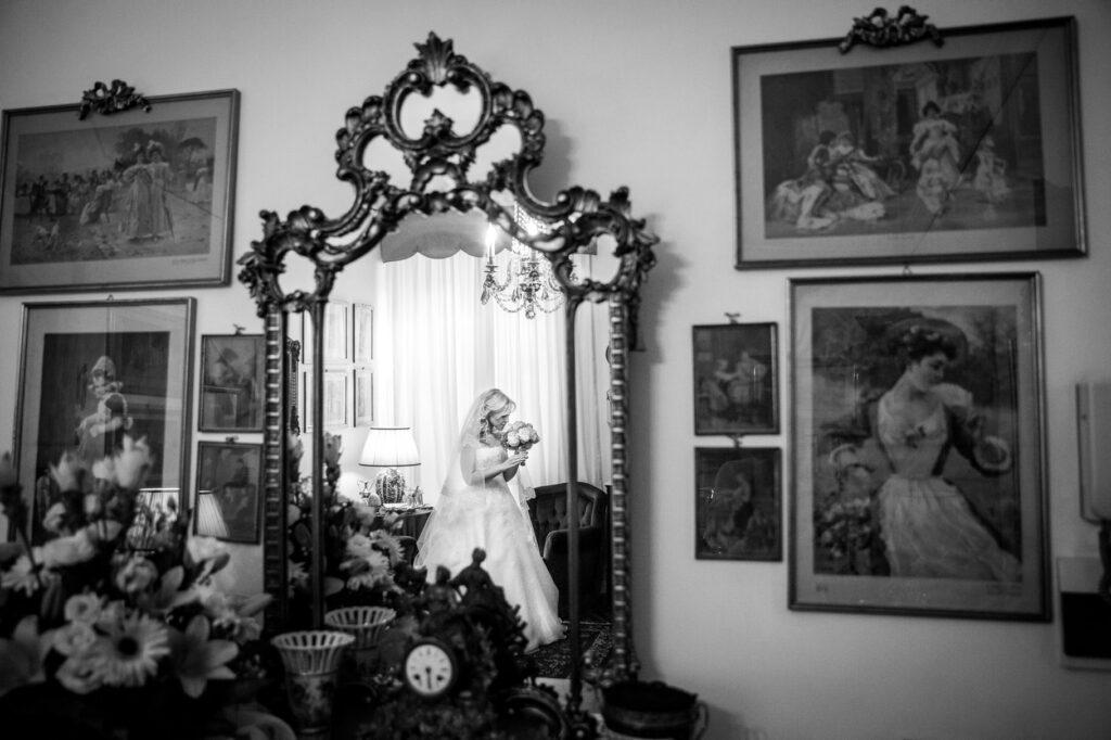 brides portrait in the mirror in a photo captured by villa miani wedding photographer