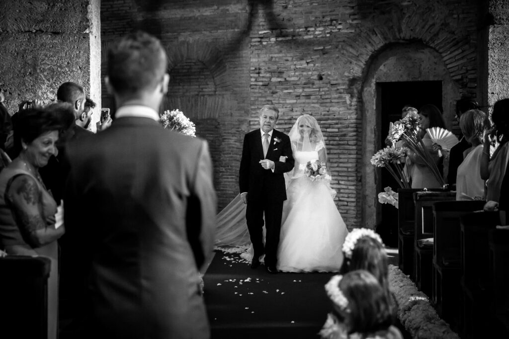 bride entrance to the church with her father photo captured by villa miani wedding photographer
