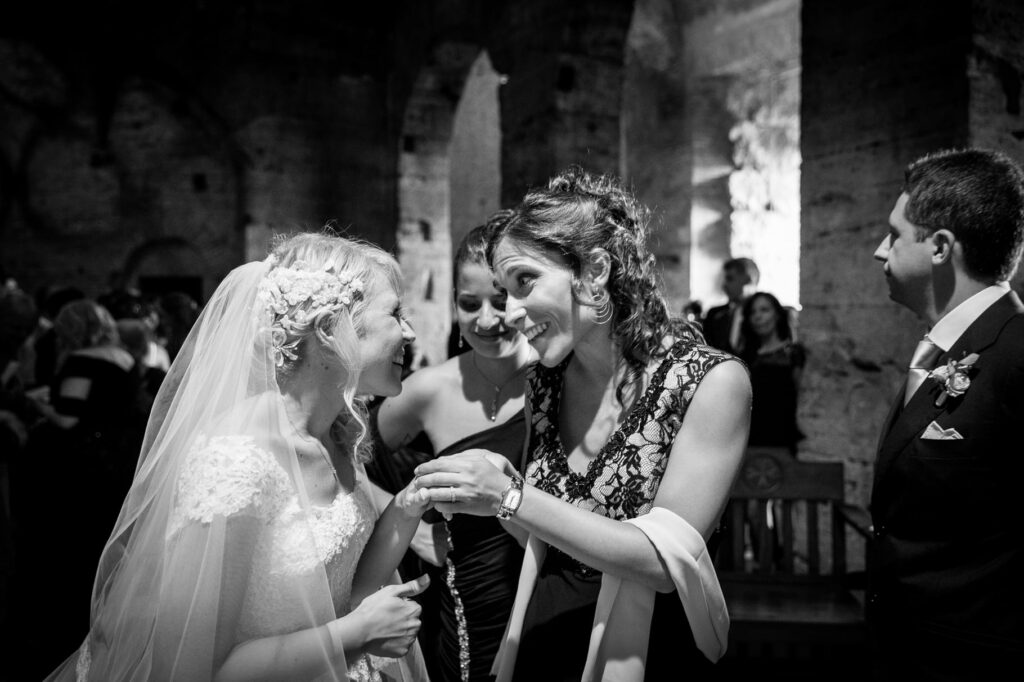 bride and bridesmaid in a photo captured by villa miani wedding photographer