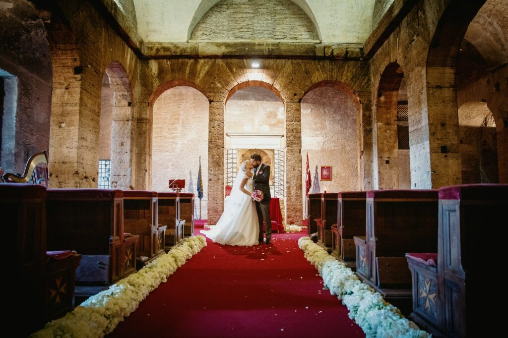 bride and groom kissing just before leaving the church