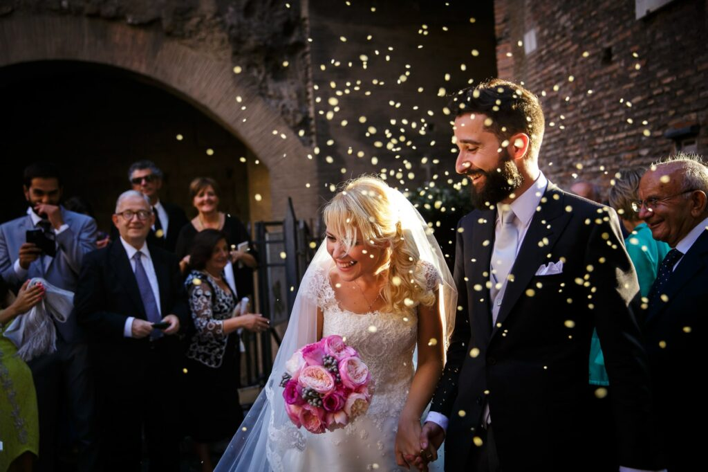 confetti throwing at bride and groom exiting the church