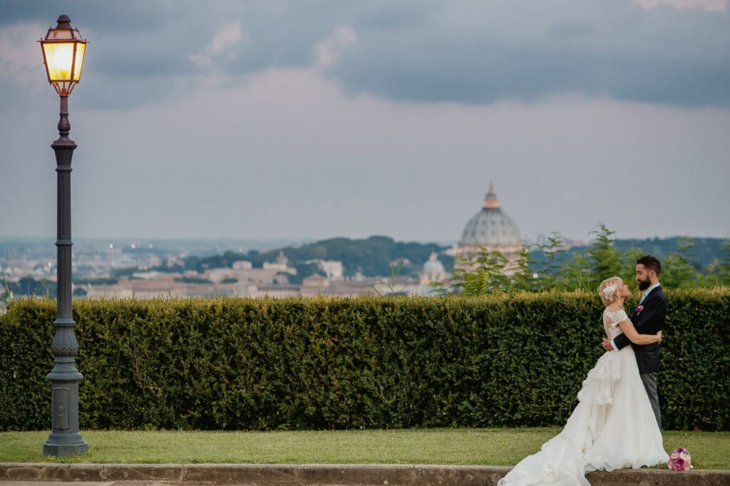couple portrait photo of bride and groom in villa miani with rome in background