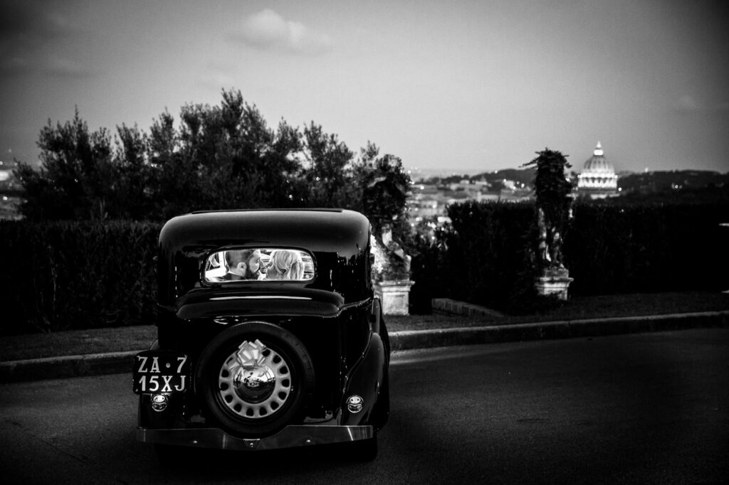 couple creative portait photo in a london cab car in villa miani