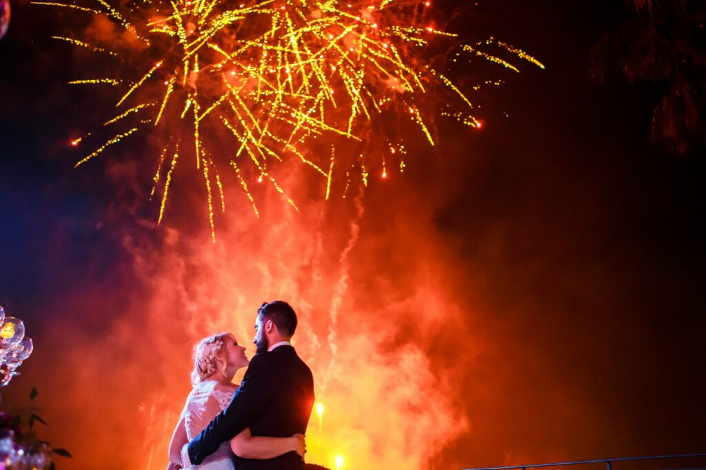 bride and groom and fireworks in a photo captured by villa miani wedding photographer