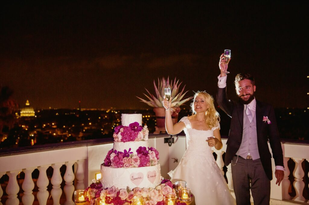 wedding cake cutting and toasting in a photo captured by villa miani wedding photographer