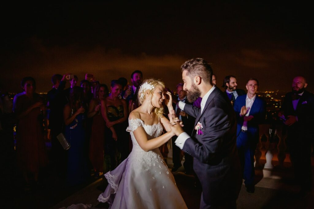 bride and groom dancing on a terrace in villa miani