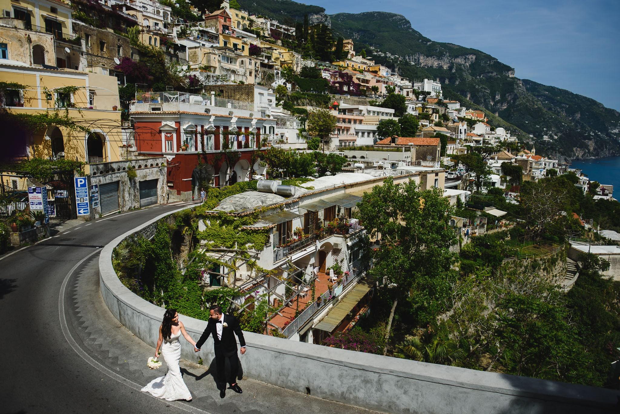 bride and groom walk before rada positano amalfi coast wedding