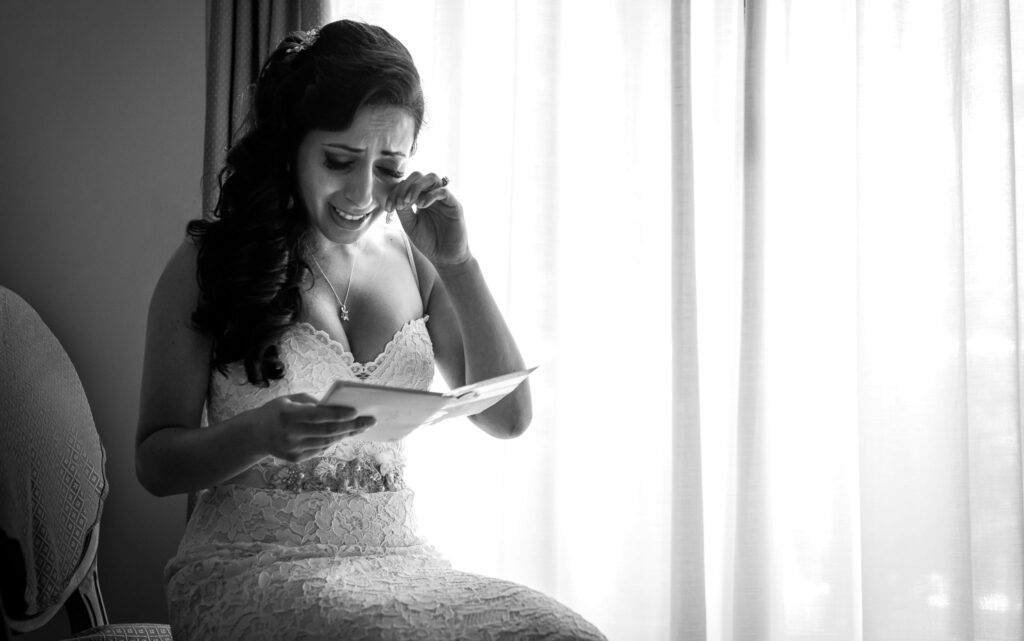 bride reads the grooms love letter and is moved