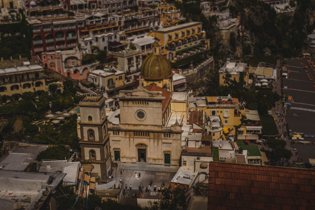 view of positano from above with newlyweds