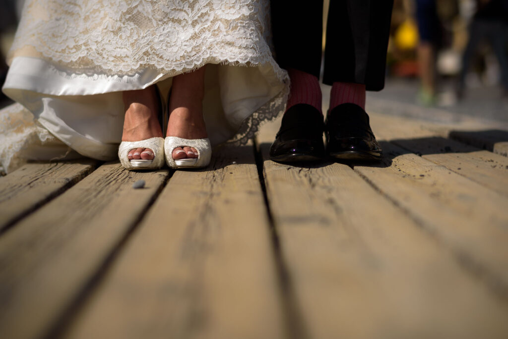 detail of bride and grooms feet and shoes