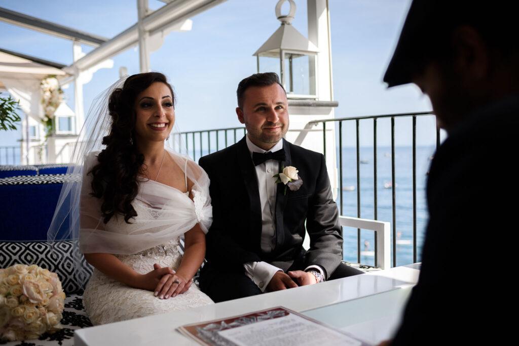 bride and groom in front of the celebrant during the intimate rada positano amalfi coast wedding