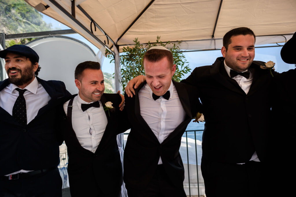 groom and best men dancing at the end of outdoor jewish ceremony