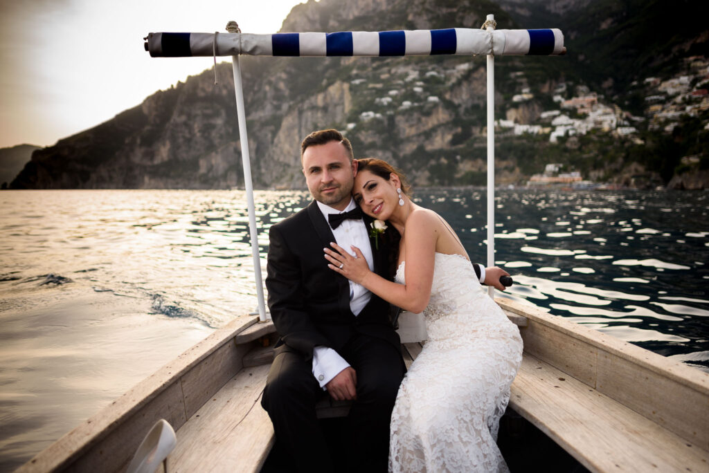 bride and groom portrait on a boat off the coast of positano