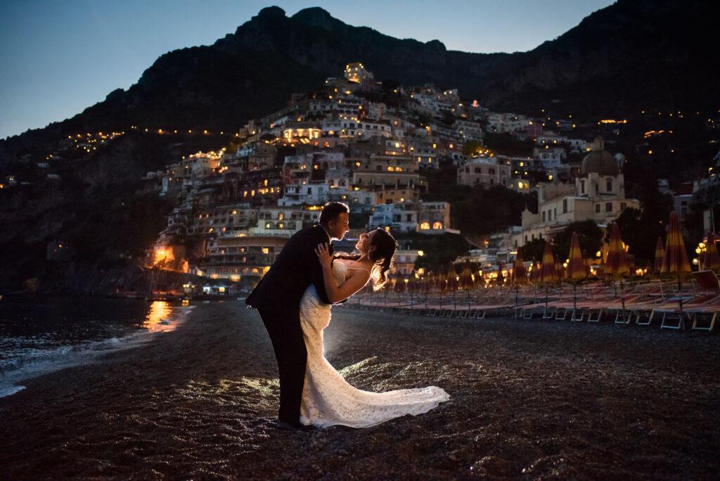 wedding couple portrait in positano beach at sunset