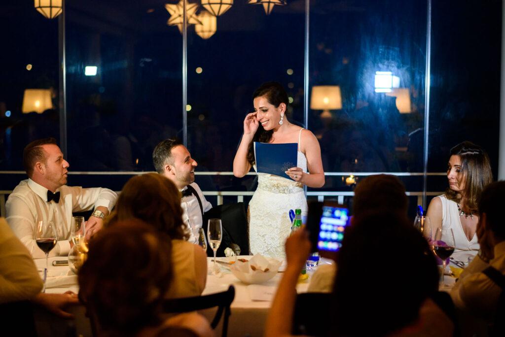 bride getting moved during her speech at rada positano wedding reception