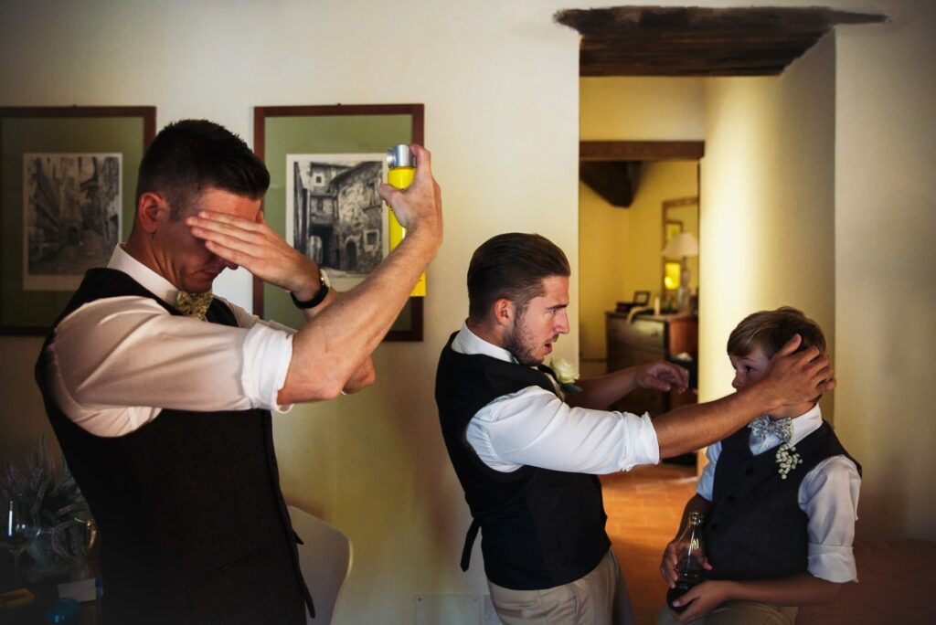 groom and bestmen getting ready before the umbria destination wedding