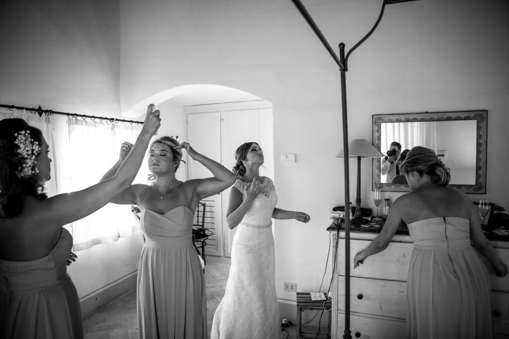 the bride and the bridesmaids getting ready