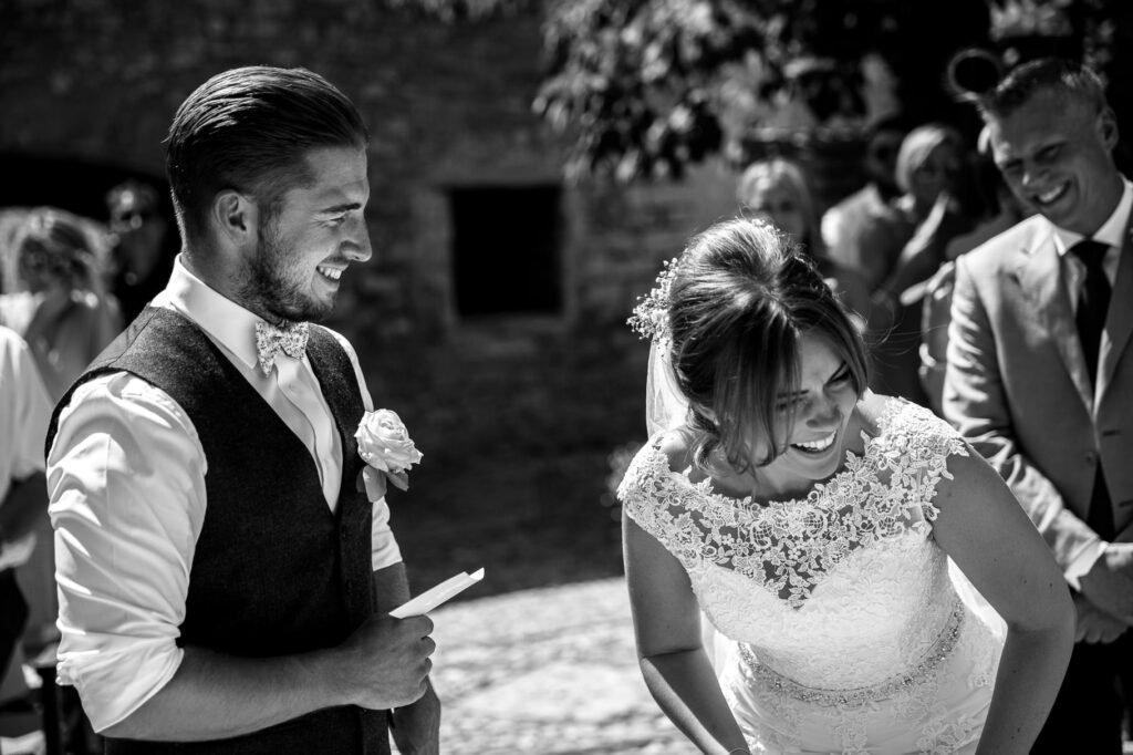bride and groom laughing during vows exchanges
