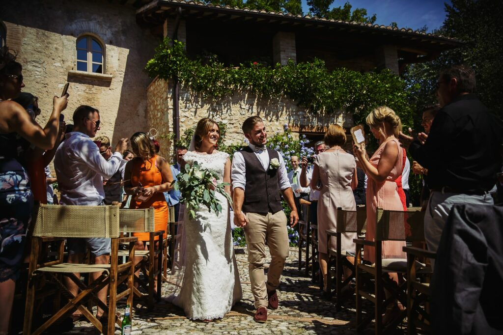 confetti aisle at the end of ceremony of umbria destination wedding at borgo della marmotta