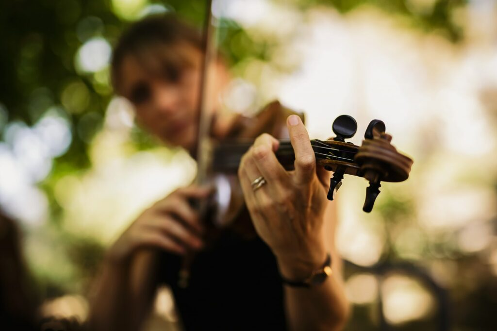 detail of violin player at the wedding reception
