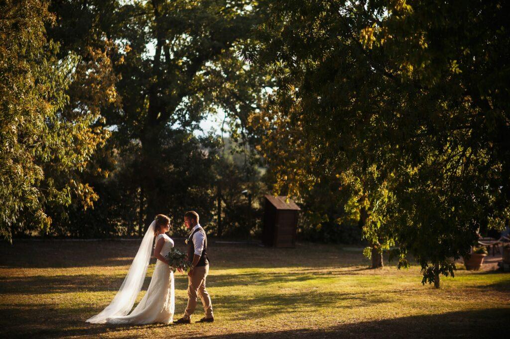 couple portait in the olives garden at borgo della marmotta
