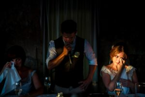 ray of light that illuminates the face of moved bride during the groom speech