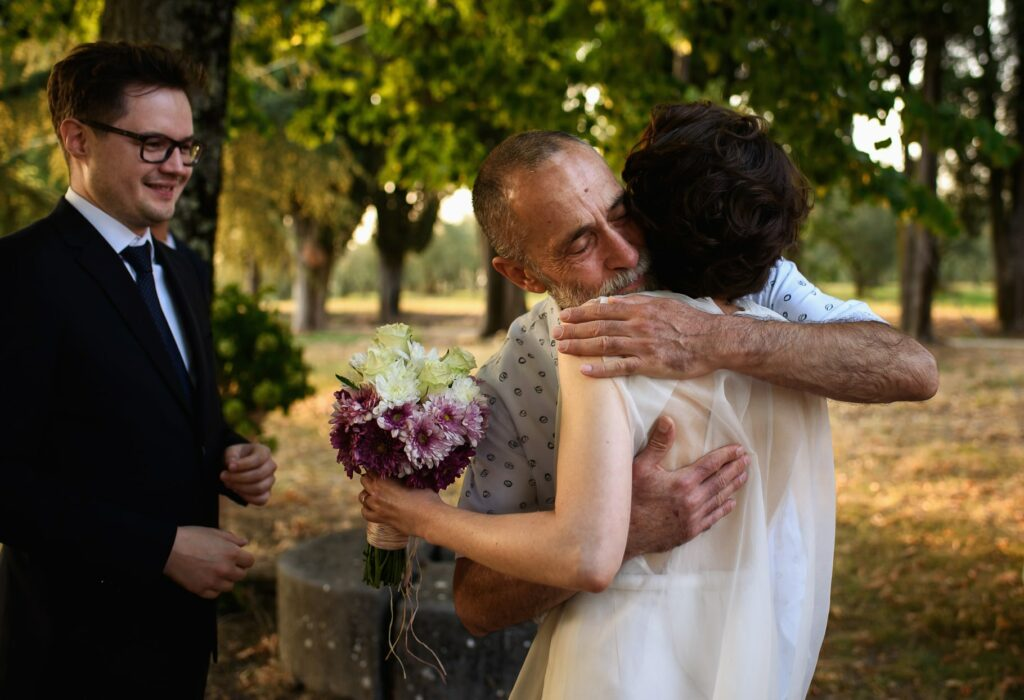 the hug of the bride with her father before the wedding ceremony in tuscany