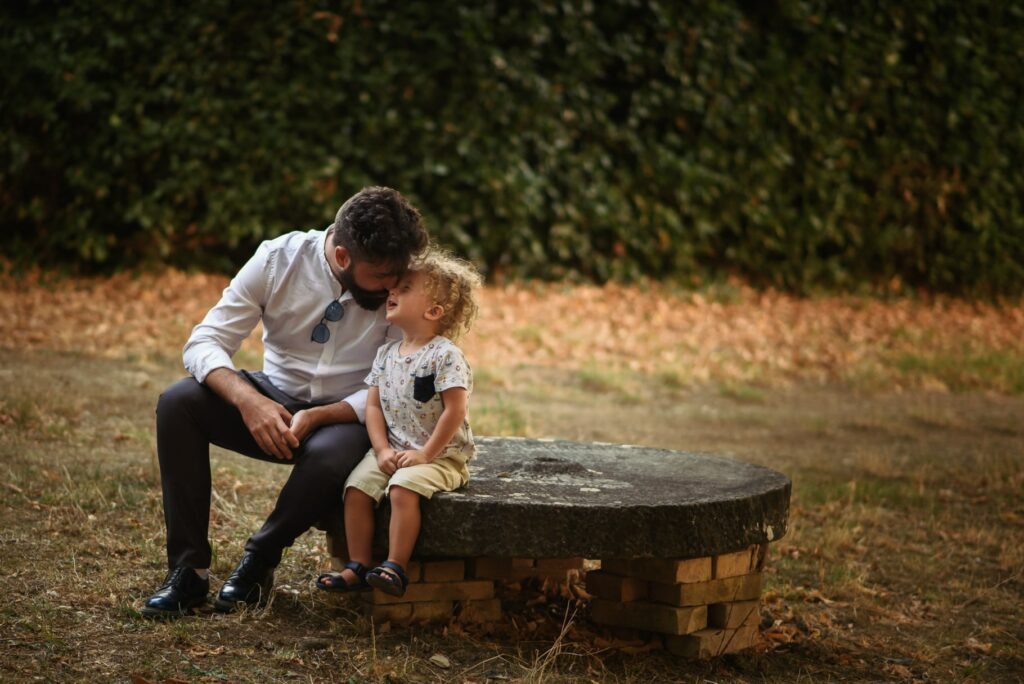 father and kid during wedding ceremony in tuscany