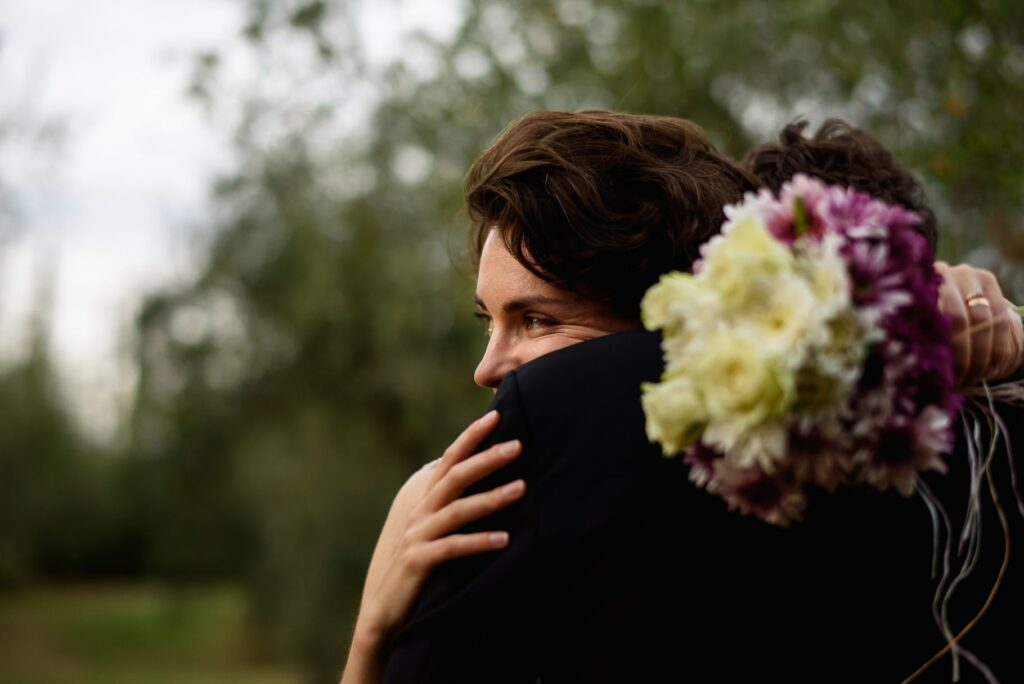 portrait of the couple in a moment of tenderness captured by the tuscany wedding photographer