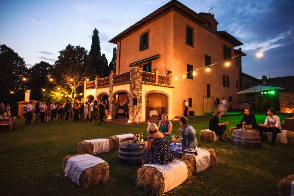 outdoor wedding at the fattorio di petroio in tuscany at sunset