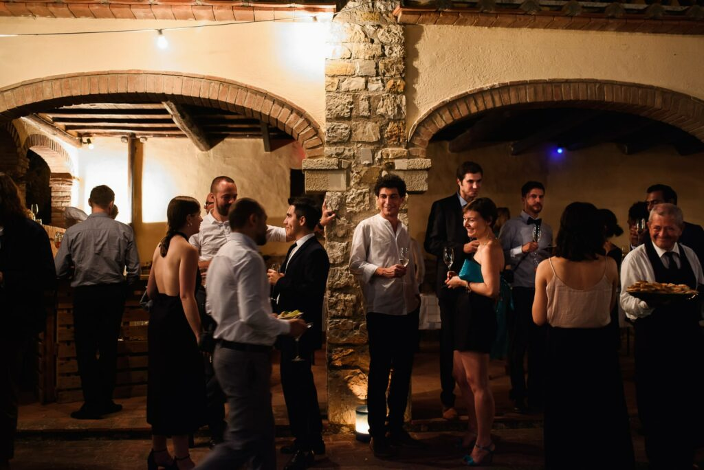 wedding guests chatting during aperitifs