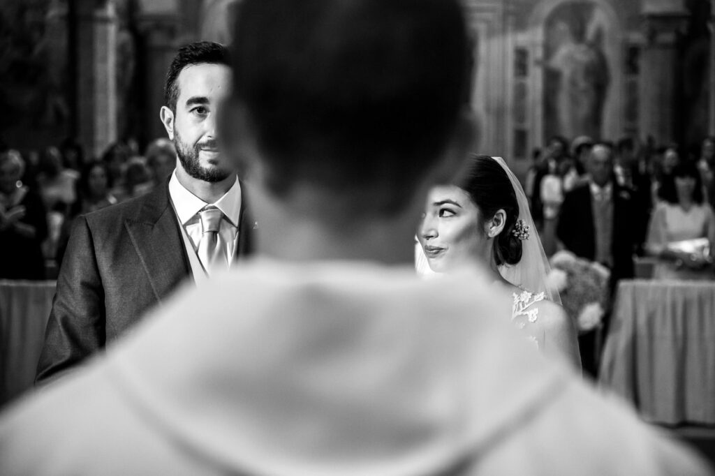 bride and groom in the church during the ceremony of the wedding at villa miani