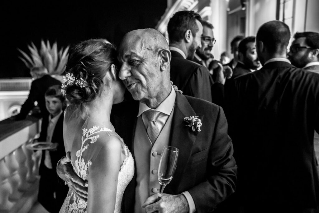 the bride with dad during the wedding reception at villa miani