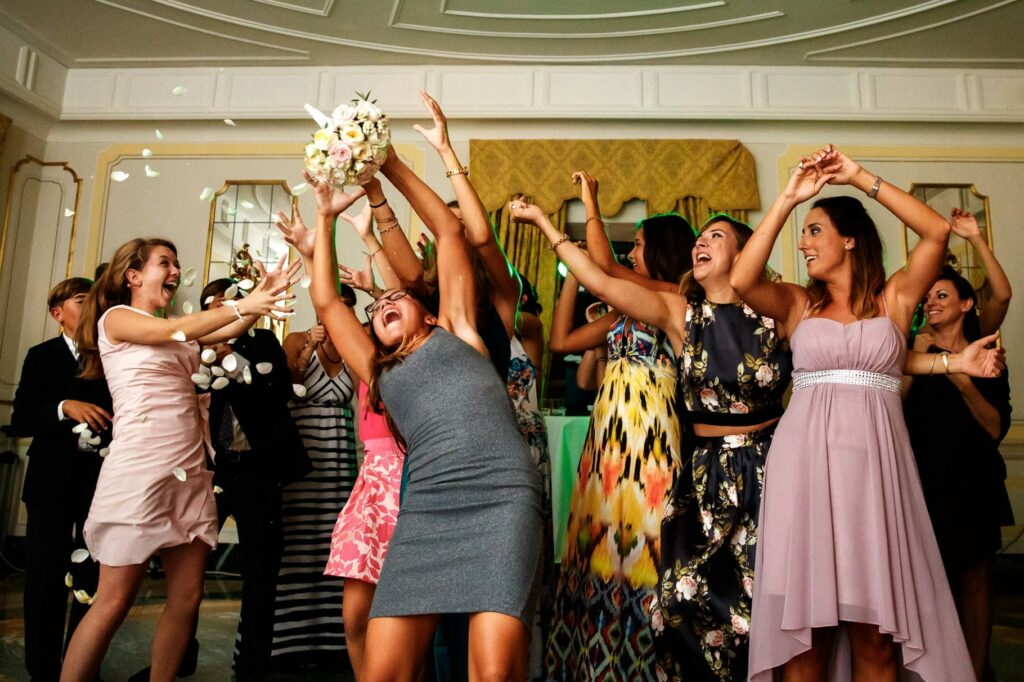 throwing the bouquet during the wedding party at villa miani