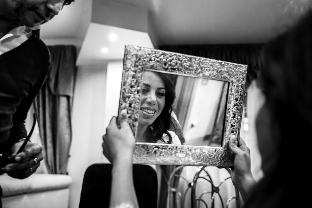 jewish wedding in rome bride looking in the mirror
