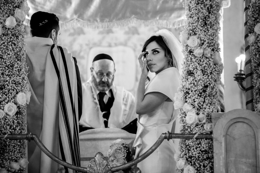 bride getting moved during the jewish rite celebration