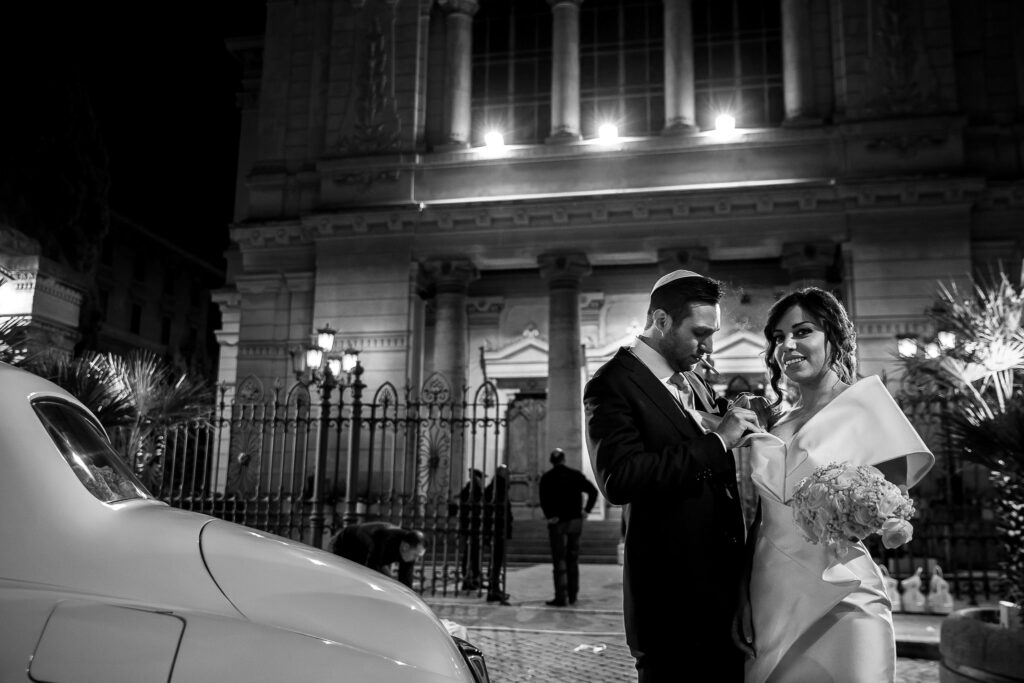 bride and groom in front of the synagogue after the ceremony