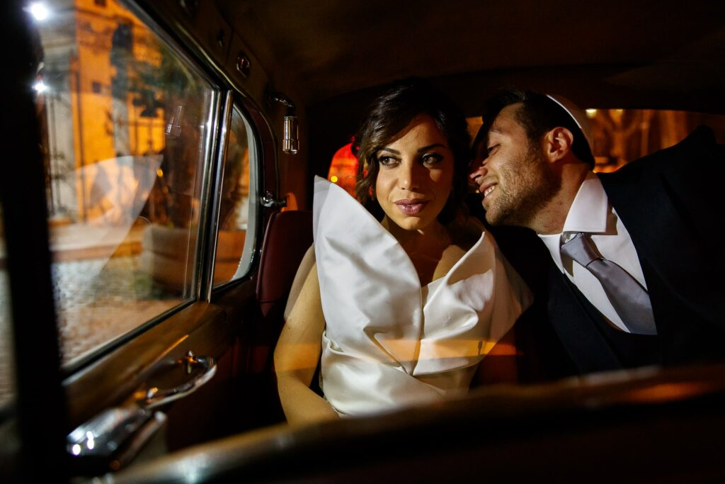 newlyweds in the car after the jewish wedding ceremony in rome