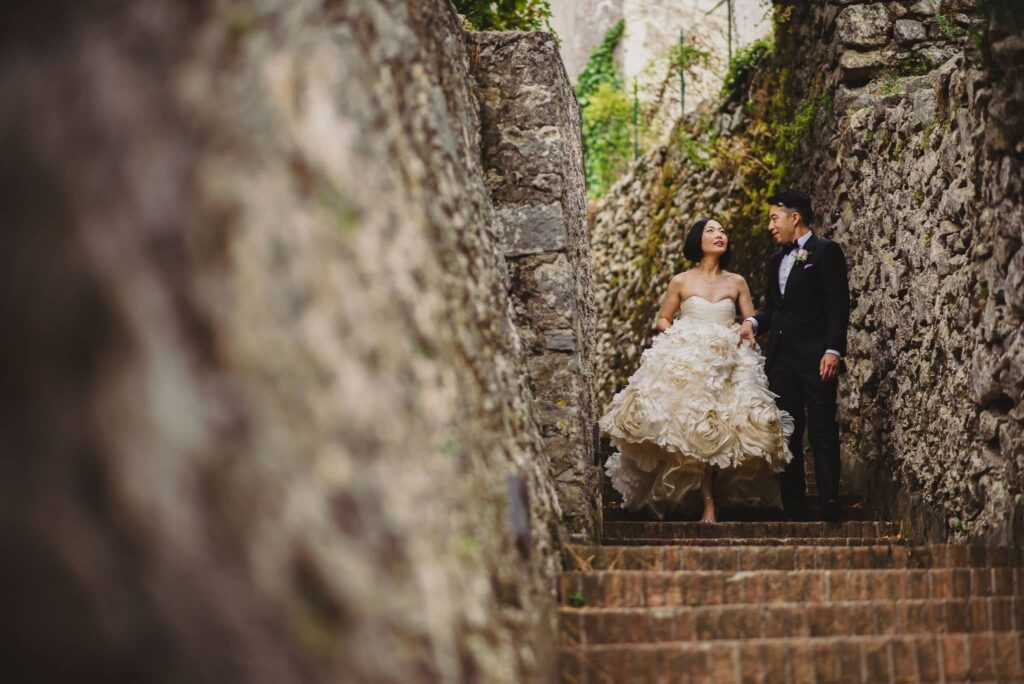 newlyweds stroll through the streets of ravello