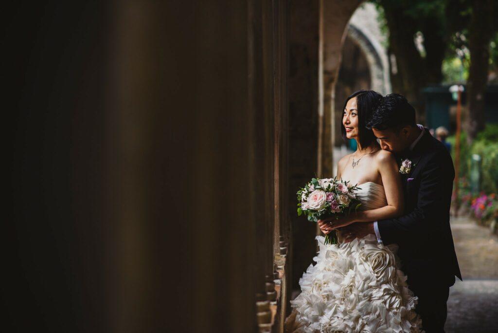 portrait of bride and groom hugging in villa rufolo ravello