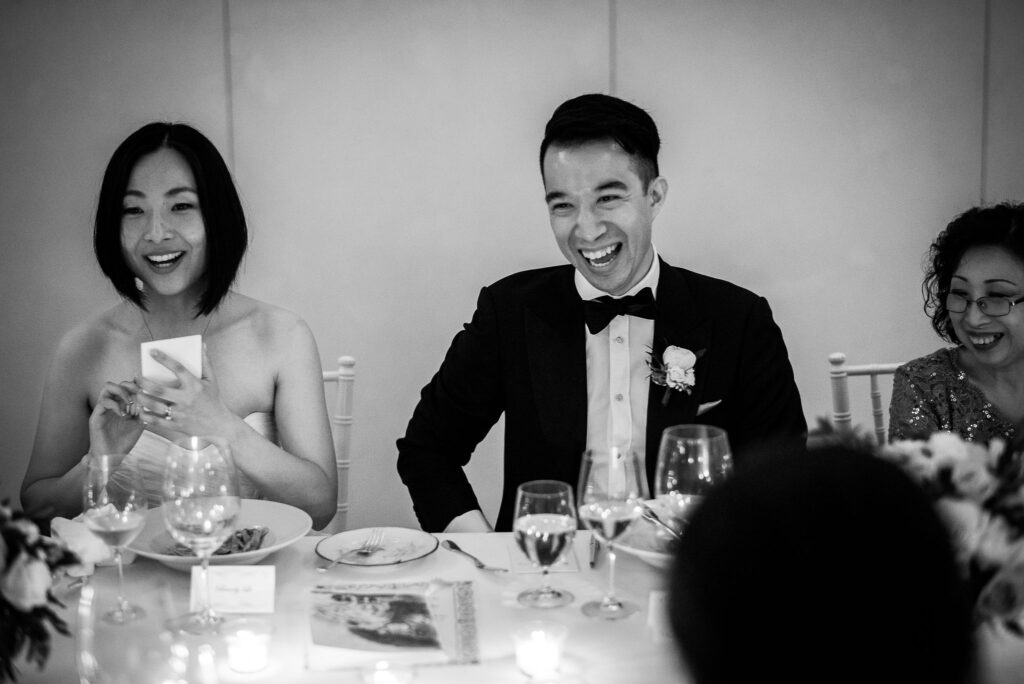 bride and groom having fun during dinner at wedding at hotel caruso in ravello