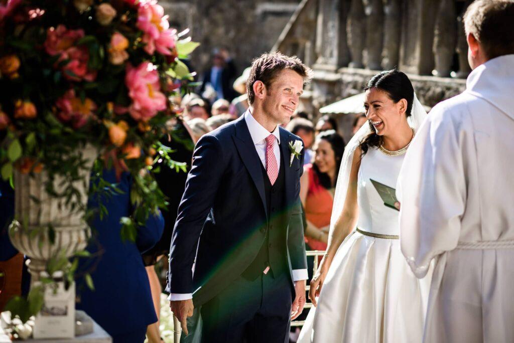 bride and groom laughing at wedding in villa gamberaia